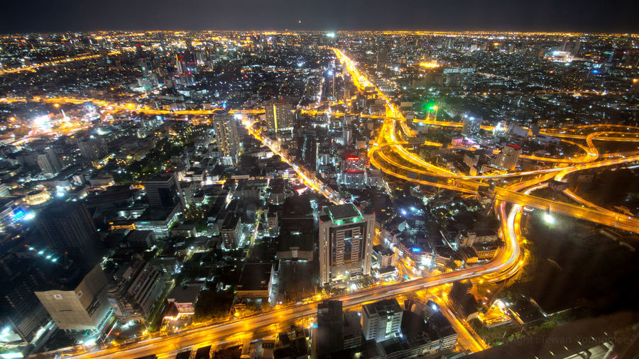 Aerial view cityscape colorful Bangkok Thailand at night. Bangkok Night City Cityscape Thailand Infrastructure View Building Expressway Light Urban Neon Road City Life City Street Modern Outdoors Light Trail Transportation High Angle View Asian  Highway Downtown Twilight Modern