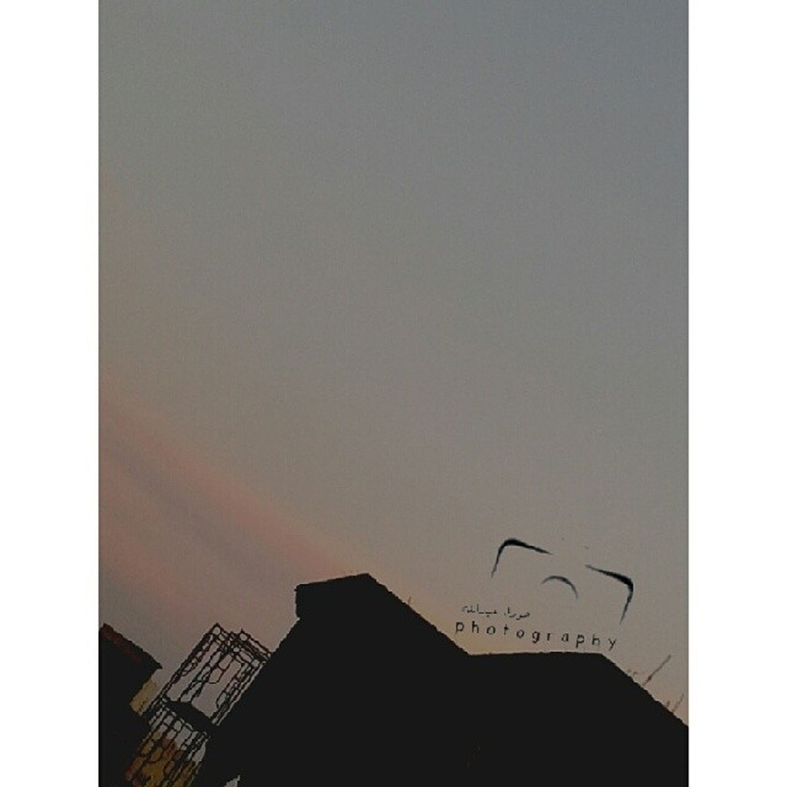 building exterior, architecture, built structure, low angle view, copy space, silhouette, building, city, clear sky, sky, high section, auto post production filter, residential structure, transfer print, residential building, sunset, dusk, house, outdoors, no people