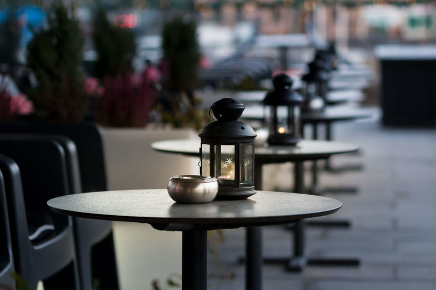 outdoors tables outside restaurant in winter in Stockholm Candle Winter Ashtray  Close-up Cold Temperature Day Focus On Foreground Lamp No People Outdoors Repeating Patterns Restaurant Table