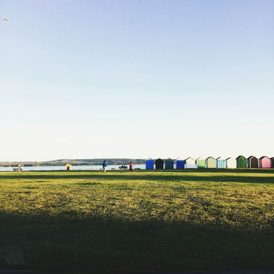 Calm Sky Happy Summer Blue Sky Green Grass Beach Huts Colourful Relaxing Kite View