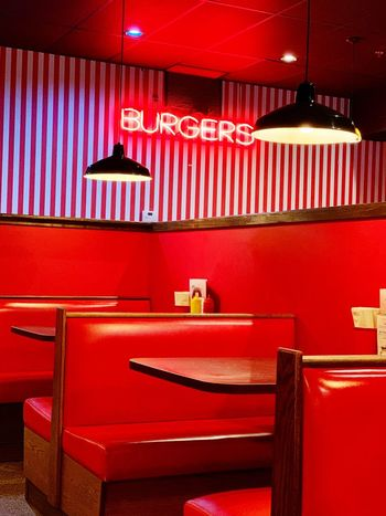Burger Joint Restaurant Diner Red Indoors  No People Architecture Built Structure Seat Wall - Building Feature Vibrant Color Chair Furniture Illuminated Table