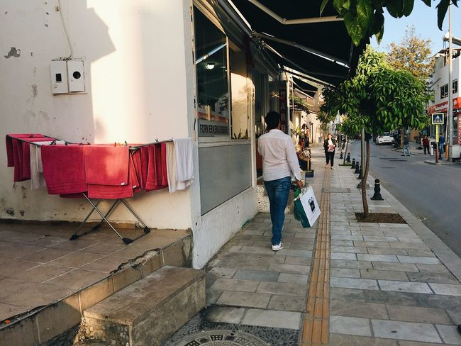 Bodrum Street Life Street Light Turkey Walking Around Architecture Building Exterior Built Structure Casual Clothing Day Dry Clothes Drying Clothes Evening Full Length One Person Outdoors Pedestrian People Real People Towels