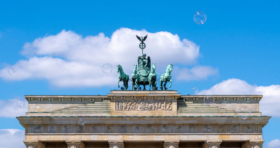 Berlin Photography Brandenburg Gate Bubbles The Traveler - 2018 EyeEm Awards Angel Architecture Art And Craft Brandenburger Tor Bubble Building Exterior Built Structure Capital Cities  City City Gate Cloud - Sky Day Famous Place History Human Representation Low Angle View Nature No People Outdoors Representation Sculpture Sky Soap Statue The Past Tourism Travel Destinations