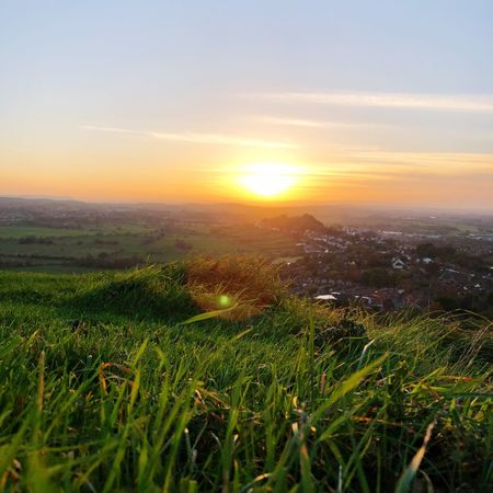 Nature Sunset Grass Nature Tranquil Scene Landscape Scenics Beauty In Nature Tranquility Field Sky Growth Orange Color No People Sun Horizon Over Land Outdoors Green Color Clear Sky Sunlight Rural Scene Glastonbury Glastonbury Tor