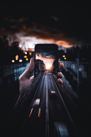 Reflection of person photographing on mobile phone