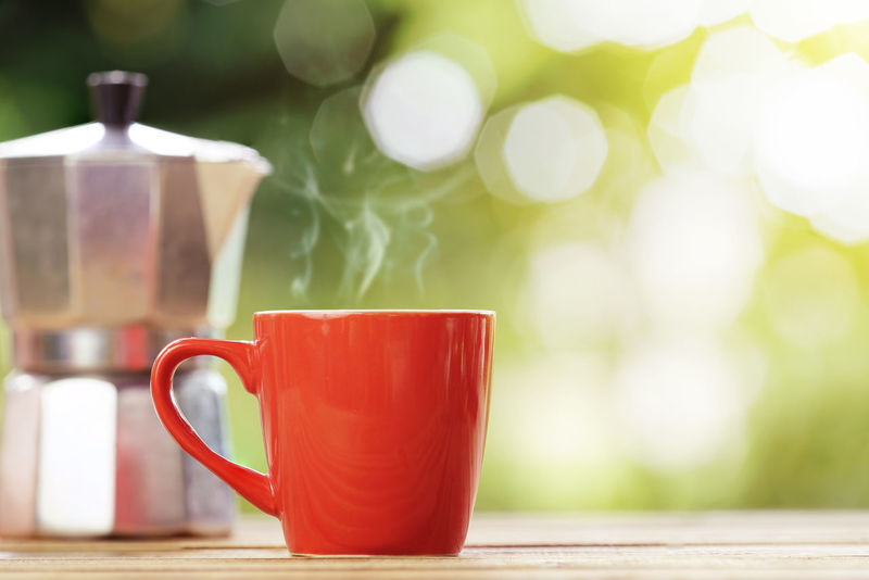 red cup of coffee with nature green background Moka Pot Steam Close-up Coffee Coffee - Drink Coffee Cup Crockery Cup Day Drink Food And Drink Freshness Hot Drink Mug No People Non-alcoholic Beverage Red Refreshment Still Life Table Tea Tea - Hot Drink Tea Cup Wood - Material
