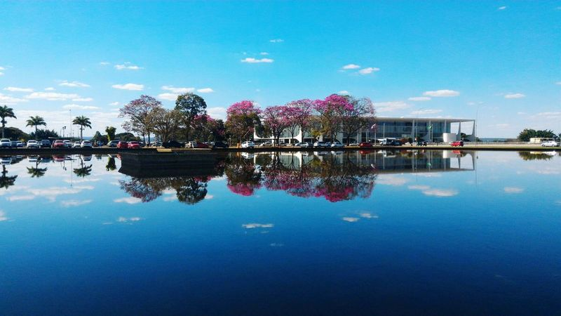 Sky In the mirror Reflection Water Waterfront Blue Architecture Built Structure Tree Building Exterior Sky Lake Tranquil Scene Tranquility House Standing Water River Scenics Cloud Calm Riverbank Day First Eyeem Photo