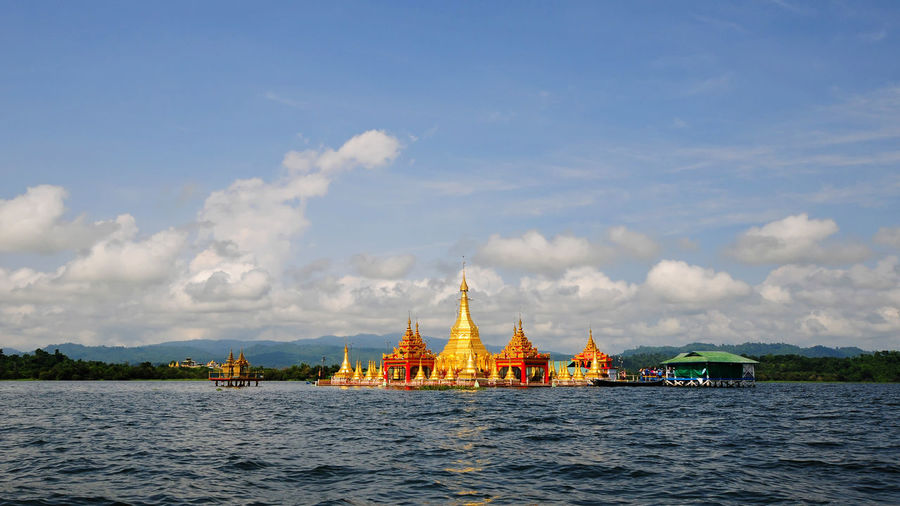 View of sea by temple against sky