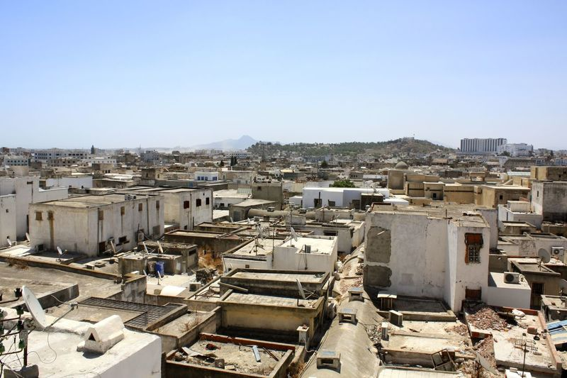 High angle view of abandoned architectural structures against clear sky