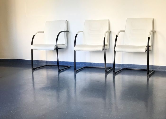 Empty chairs at waiting area