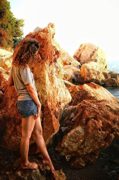 tipping the rock One Person Young Adult Full Length Adult Standing One Woman Only Only Women Adults Only Water Nature One Young Woman Only Outdoors People Young Women Day Side View Sand Sky Smartphonephotography Summer Vacations Beauty In Nature Tree