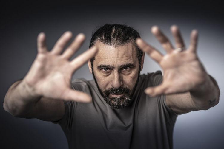 Man Long-hair Caucasian Casual Open Hands Up Confident  50s Beard Bearded Portrait Studio Expression Face Dof Selective-focus