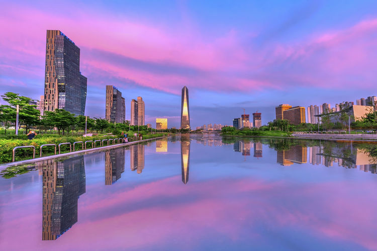 INCHEON, KOREA Songdo Central Park in Incheon, South Korea Architecture Building Building Exterior Built Structure City Cityscape Cloud - Sky Financial District  Lake Luxury Modern Nature No People Office Building Exterior Outdoors Reflection Sky Skyscraper Sunset Tall - High Urban Skyline Water Waterfront
