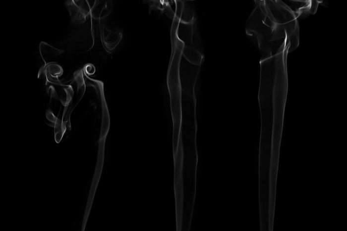 White smoke isolated on black background. Flow smoke or fog effect for montage. Black Background Smoke - Physical Structure Studio Shot Motion Pattern Abstract No People Indoors  Close-up Swirl Incense Black Color Burning Changing Form Moving Up Curve Nature Textured  White Color Flowing Luminosity Wispy Smoke Smog Fog