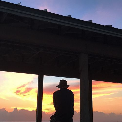 One Person Real People Silhouette Lifestyles Built Structure Low Angle View Sunset Clear Sky Outdoors Strength Architecture Men Day Sky Nature One Man Only Adult People Contemplating the sunrise in vero beach Florida 🇺🇸 Welcome To Black Long Goodbye The Secret Spaces The Portraitist - 2017 EyeEm Awards