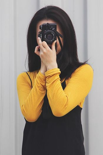 Midsection of woman photographing