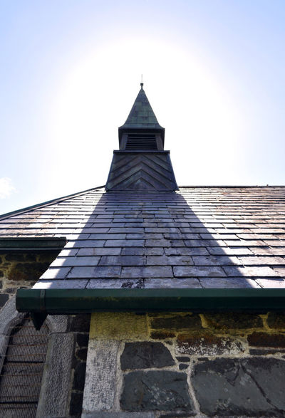 Abandoned Church Church Stone Church Abandoned Buildings Architecture Building Exterior Built Structure Church Bell Tower Clear Sky Day High Noon High Noon Lighting Low Angle View Nature No People Outdoors Roof Roof Shingles Shingles Sky Spirituality Sunlight