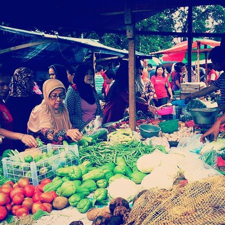 People at vegetables traditional market. Vegetable Traditional Market Kota Serang banten morning Activity pasar Tamansari Seller Buyer vintage