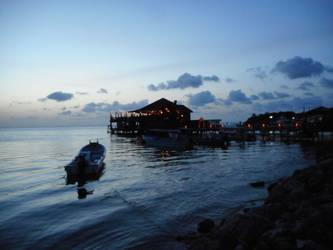 Honduras Roatan Architecture Bay Islands Beach Beauty In Nature Built Structure Cloud - Sky Day Nature Nautical Vessel No People Outdoors Sea Silhouette Sky Sunset Tranquility Water