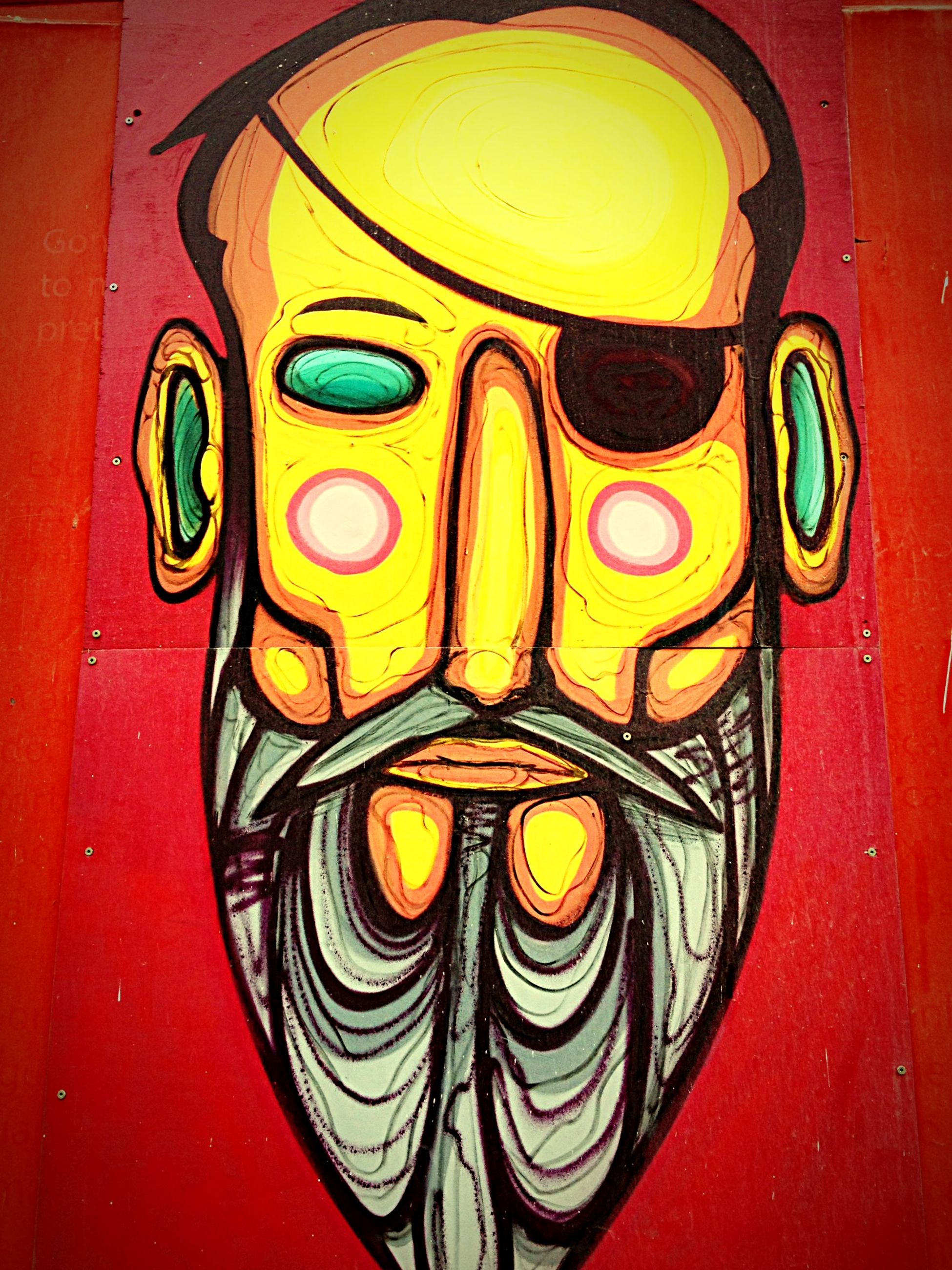multi colored, art and craft, art, creativity, indoors, yellow, human representation, close-up, pattern, circle, no people, red, graffiti, design, colorful, wall - building feature, day, animal representation, anthropomorphic face