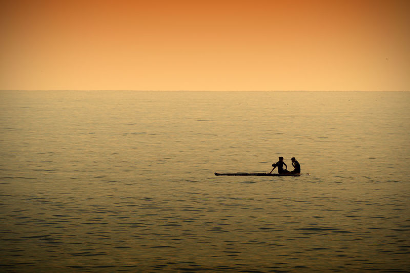 Activity Beach Couple Evening Love Paddleboarding Paddlesurf Sea Shilouette Sport Sunset Surf Travel
