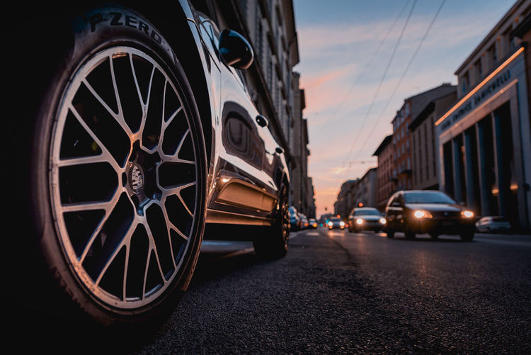 Cars on street in city during sunset