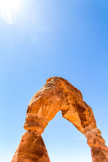 View of natural arch against clear sky during sunny day