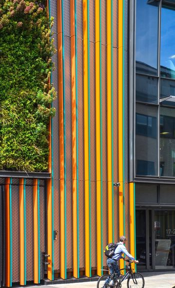 CityCruising Reflection Urban Green Greenery Lines Modern Architecture London Street Photography Urban Impressions Urban Geometry Street Cyclist Built Structure Architecture Building Exterior Day Building Nature Plant Sunlight Outdoors Orange Color Window Metal City Pattern Wall - Building Feature Growth The Architect - 2018 EyeEm Awards The Street Photographer - 2018 EyeEm Awards