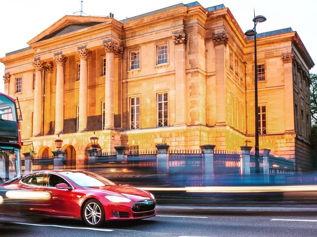 Tesla Model S stopped in traffic outside Apsley House in Mayfair, London - Car Building Exterior Architecture Built Structure Transportation Land Vehicle City Outdoors Road Day Illuminated No People Sky Tesla Teslamotors