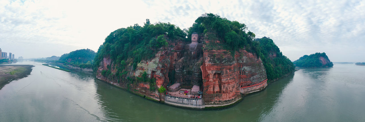Leshan Giant Buddha China Sichuan Leshan Giant Buddha Buddha Buddha Statue Statue Art River Water Travel Travel Destinations Nature No People Beauty In Nature Sky Scenics - Nature Tranquility Tranquil Scene Cloud - Sky Panoramic Panoramic Photography Panoramic View Panoramic Landscape Architecture Mountain Rock - Object Tree History Nature Beauty In Nature Sculpture Outdoors Land Rock Rock Formation Day Aerial View