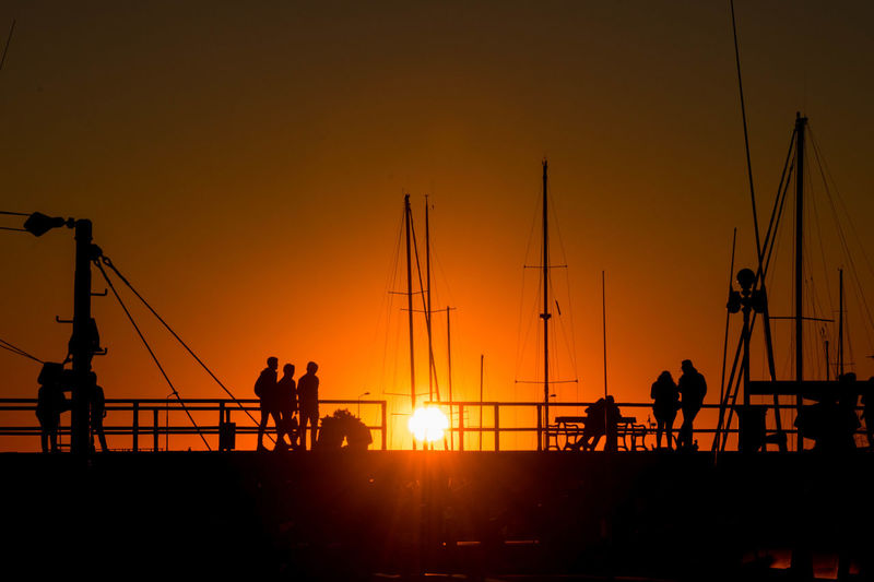 Backlighting Photography Boats⛵️ Colonia Del Sacramento, Uruguay Lifestyles Light Light And Shadow Nature Orange Color Outdoors People Port Real People Sailing Boat Silhouette Sky Sunset EyeEmNewHere