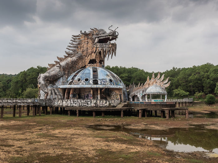Abandoned Water Park near Hue Architecture Built Structure Sky Water Cloud - Sky Nature Tree Building Exterior Day Plant Lake No People Connection Art And Craft Travel Destinations Building History The Past Bridge Outdoors Urbex
