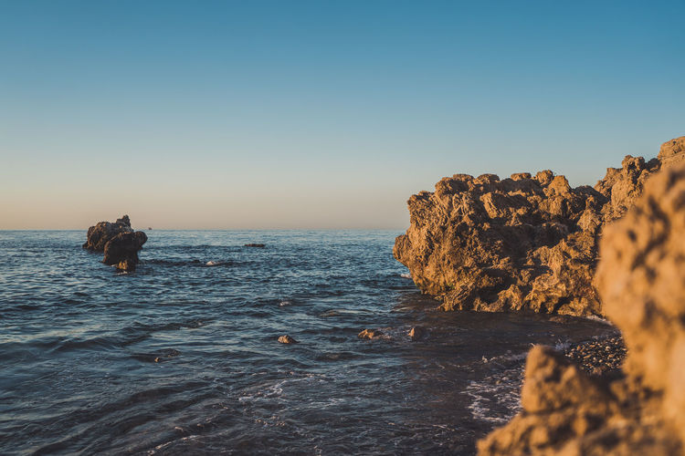 Morning lights Light Morning Morning Light Summertime Beauty In Nature Clear Sky Horizon Horizon Over Water Mood Nature Outdoors Rock Rock - Object Rock Formation Scenics - Nature Sea Sky Solid Summer Water Waterfront