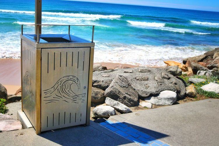 A beautiful photo of something ugly. Another bin with a view. Beach Bin Street Bin Outdoors Day Sunlight Water No People Sand Cronulla Bin Views Ugly Subject EyeEmNewHere Canon EOS 750D Edited With Snapseed