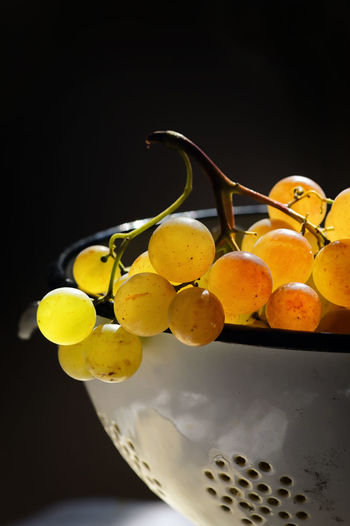 Close-up of yellow fruits against black background