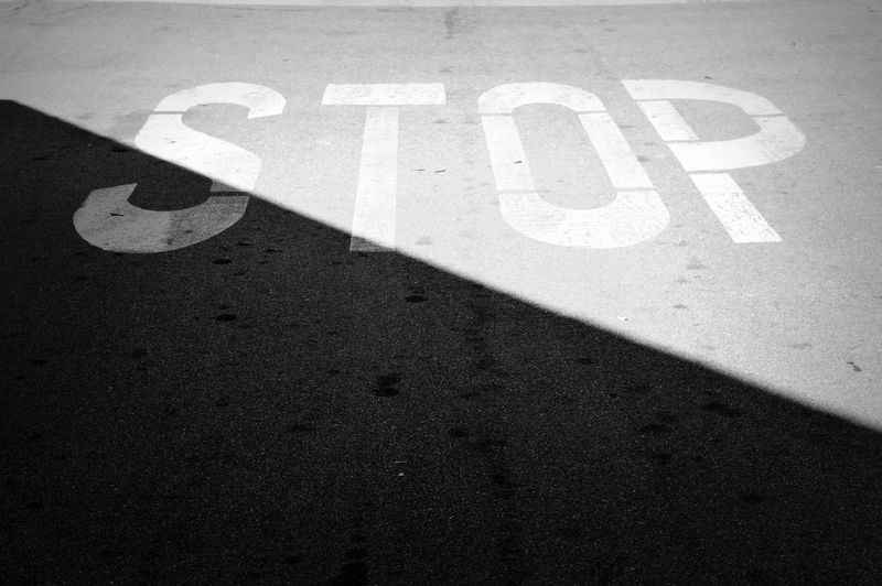 Close-Up Of Stop Sign On Road