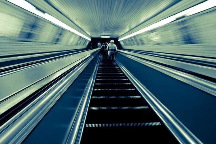 Going down Moving Walkway  Technology Built Structure Architecture Futuristic Modern Indoors  Metro Blue Goingdown Stairs Adapted To The City Welcome To Black