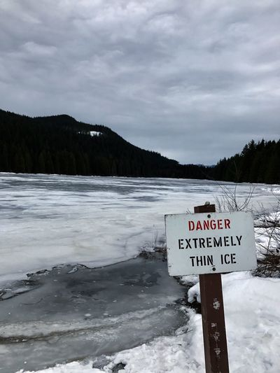 EyeEmNewHere Frozen Snow Cold Temperature Nature Winter Sign Warning Sign Frozen Lake Ice Caution Danger Carefull Stop Communication Outdoors