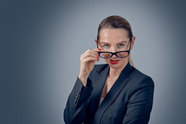 Business executive peering over her glasses Business Glasses Lawyer Woman Beautiful Woman Business Businesswoman Ceo Confident  Copy Space Eyeglasses  Headshot Indoors  Looking At Camera One Person Peering Portrait Red Lipstick Serious Standing Studio Shot Well-dressed