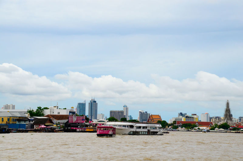 The Transportation onwater life Along Chawphaya River of Capital of Bangkok on the moment at this time. Architecture Building Exterior Built Structure City Cityscape Cloud - Sky Day Modern No People Outdoors Sky Skyscraper