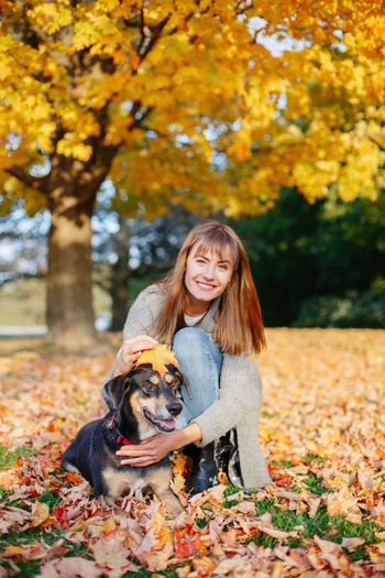 Woman with dog in autumn