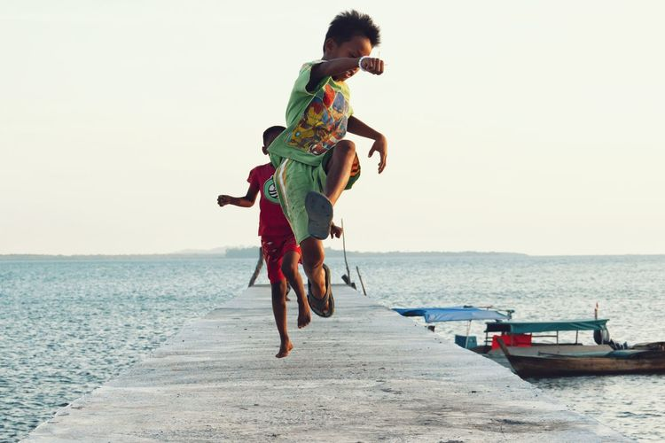 Summer Children Only Childhood Summer Playing Mid-air Leisure Activity Children Kids Daylight Having Fun Enjoying Life Beach Sea Sand Outdoors Full Length Horizon Over Water Day Vacations Water Nature Sky Scenics