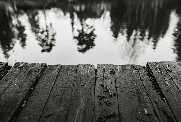 Close-up of wooden pier over lake