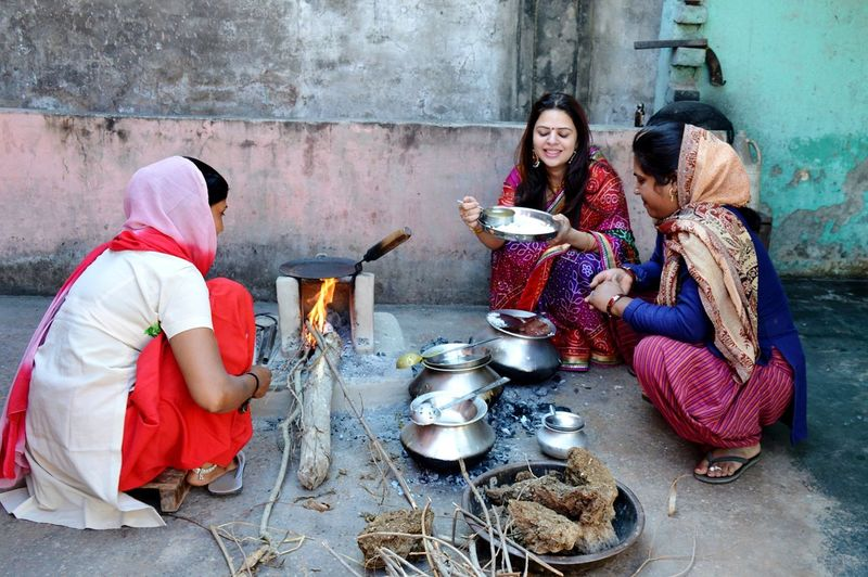 Women preparing food on terrace