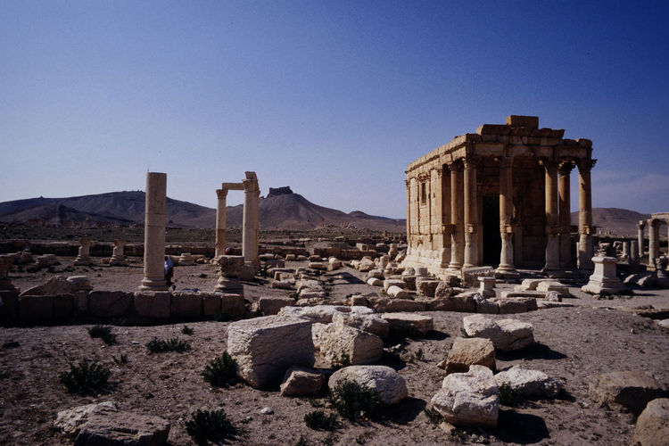 1991 Palmyra Ruins History Architecture The Past Ancient Built Structure Sky Ancient Civilization Old Ruin Architectural Column Archaeology Travel Destinations Copy Space Travel Clear Sky Nature Tourism Place Of Worship No People Old Building Exterior Ruined Outdoors Deterioration