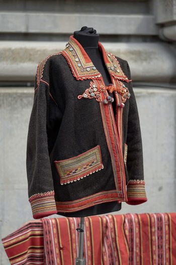 Old-fashioned Arts Culture And Entertainment Black Clothing Coat Day Fair Focus On Foreground Outdoors Rear View Red Standing Textile Traditional Clothing Uniform