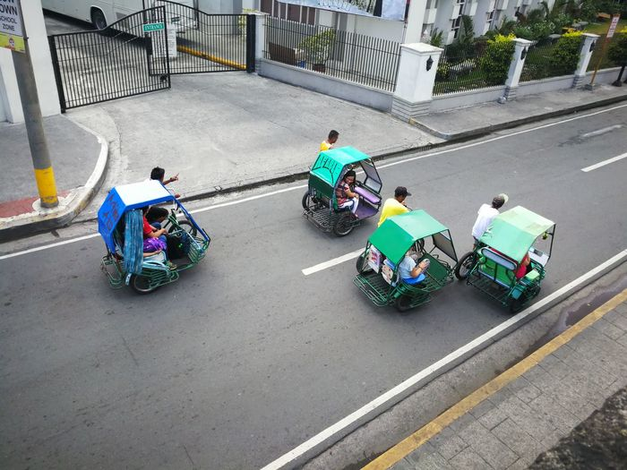 race you till the end Adult Adults Only Competition Crash Helmet Day Eyeem Philippines Headwear Huaweimobile Kokopaps Men Mobile Photography Mode Of Transport Outdoors Pedicab People Real People Riding Smartphone Photography Teamwork Transportation Women