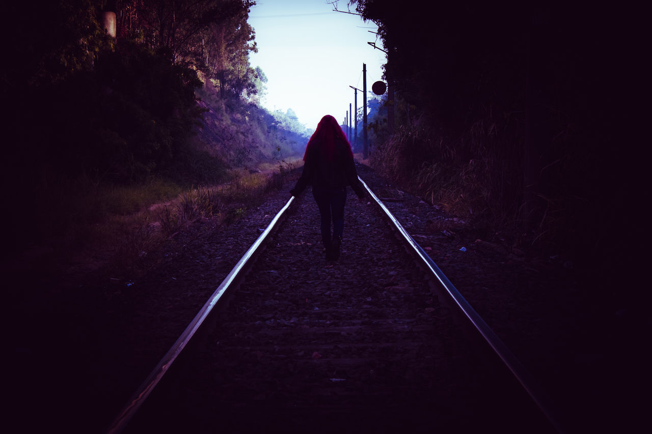 the way forward, full length, one person, real people, rear view, silhouette, day, railroad track, leisure activity, outdoors, women, straight, standing, men, nature, tree, adult, people