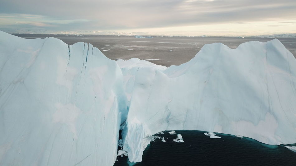 With very windy conditions, I managed to fly over this and not crash. Drone  EyeEm Best Shots EyeEm Best Shots - Nature EyeEm Nature Lover Icebergs Ilulissat Ilulissat Icefjord The Real Greenland This Is Greenland Drone Photography Dronephotography Iceberg