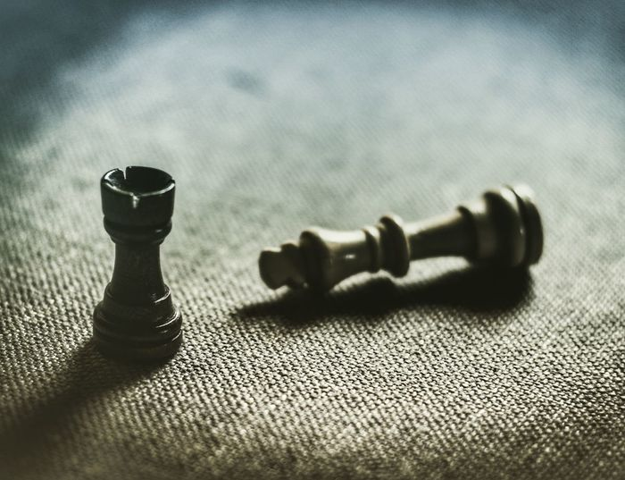 Close-up of chess piece on table